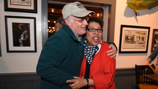 Franklin resident Julian Bibb, left, hugs City of Franklin alderman Pearl Bransford after she won re-election on Oct. 27, 2015. Bransford held an election night party at Puckett's Boat House.
