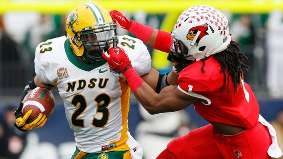 Jan 10, 2015; Frisco, TX, USA;North Dakota State Bison running back John Crockett (23) is face masked by Illinois State Redbirds safety Tevin Allen (1) in the first quarter  of the Division I championship at Pizza Hut Park. Mandatory Credit: Tim Heitman-USA TODAY Sports