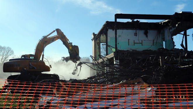 A construction crew works Thursday to demolish Smith Middle School on Arch Street.