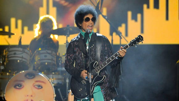 In this May 19, 2013, file photo, Prince performs at