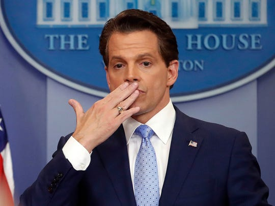 In this July 21, 2017 photo, incoming White House communications director Anthony Scaramucci, blowis a kiss after answering questions during the press briefing in the Brady Press Briefing room of the White House in Washington.