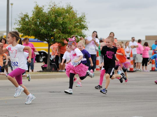 Kids run for the Kids Dash during 18th annual Susuan G. Komen Evansville Race for the Cure at the Eastland Mall in 2015.