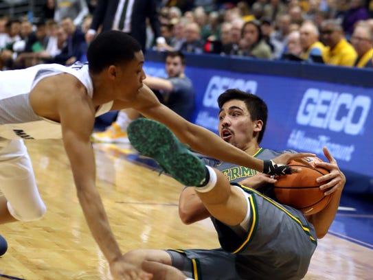 Vermont Catamounts guard Everett Duncan fights to retain