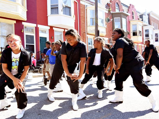 The Crispus Attucks South Side Steppers perform during the South Duke Street Block Party hosted by Crispus Attucks and South Duke Street Neighborhood Association is shown in York, Pa. on Saturday, Sept. 19, 2015.   Dawn J. Sagert - dsagert@yorkdispatch.com