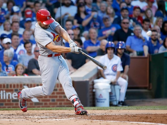 St. Louis Cardinals' Matt Holliday hits a two-run home run off Chicago Cubs starting pitcher Jason Hammel, also scoring Aledmys Diaz during the third inning of a baseball game Tuesday, June 21, 2016, in Chicago. (AP Photo/Charles Rex Arbogast)