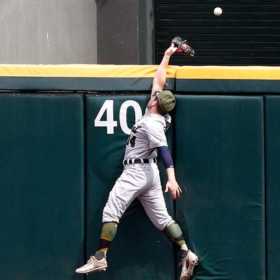 Tigers centerfielder Alex Presley can't make the play