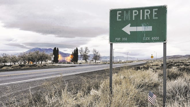 A sign points to the town of Empire on Thursday off Nevada 447 leading to Gerlach and the Black Rock Desert. The USG Corp. plant in Empire closed at the end of January 2011.