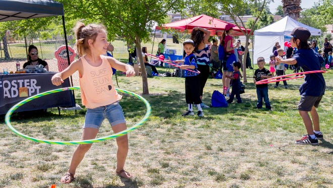 Chayce Dye, 6, of Las Cruces, shows off her hula hoop skills as part of Kid Fit held Saturday morning at Young Park. April 22, 2017. A variety of activities and attractions are planned for June 7 at the Young Park parking lot.