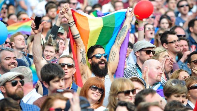 People reacting to the Irish referendum on same-sex marriage on Saturday.