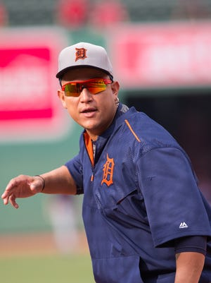 Injured Tigers first baseman Miguel Cabrera warms up before a game against the Red Sox at Fenway Park on Friday.