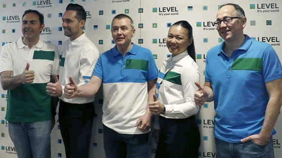 IAG group CEO Willie Walsh (center) gives a thumbs-up at a press event launching the new low-cost airline 'Level' in Barcelona on March 17, 2017.
