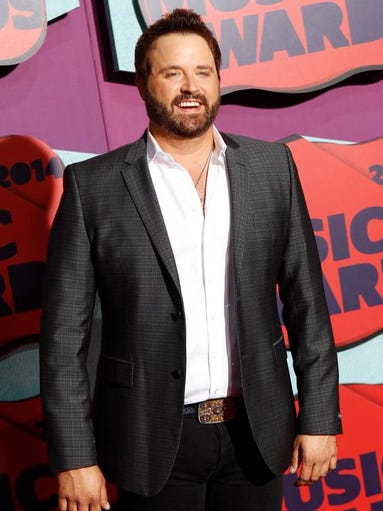 Randy Houser arrives at the CMT Music Awards at Bridgestone Arena on Wednesday, June 4, 2014, in Nashville, Tenn.