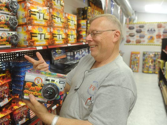 Dennis Coster, manager at Fireworks Fantasy near Glen Rock, jokes about the different names of fireworks in his store on Friday, June 19, 2015.