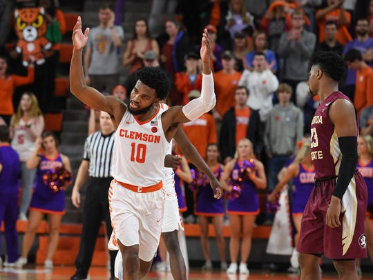 Clemson guard Gabe DeVoe (10) acknowledges the Clemson