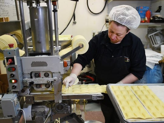Enza Amato makes some traditional cheese ravioli. The store churns out 75 varieties, and counting.