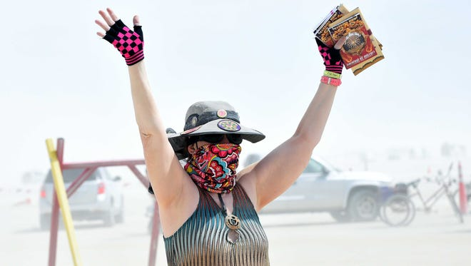 Dust and greeters greet burners on opening day at Burning Man on the Black Rock Desert on August 30, 2015.