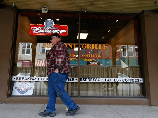 A Marshalltown resident walks into the Tremont Grille on April 15, 2015, in downtown Marshalltown, Iowa.