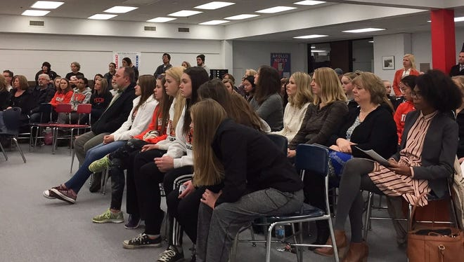 Nearly 100 people attended the St. Cloud school board meeting Wednesday, Feb. 8, to urge board members to dedicate space for gymnastics in the new high school.