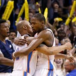 Oklahoma City Thunder forward Kevin Durant (35) embraces teammate Caron Butler (left) after the Thunder defeated the Detroit Pistons in a game Wednesday in Oklahoma City.
