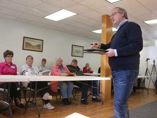 U.S. Rep. David Young answers a question from a constituent. Young conducted a town-hall meeting at the Milo Community Center on Jan. 26.