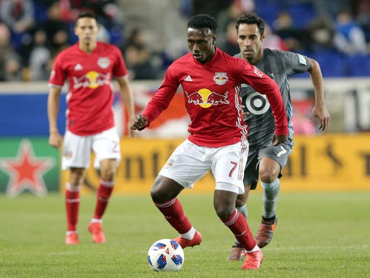 New York Red Bulls midfielder Derrick Etienne (7) controls the ball against Minnesota United midfielder Ibson (7) during the second half at Red Bull Arena.