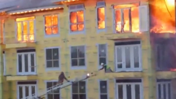 Construction worker Curtis Reissig is rescued from the ledge of a burning Houston building.