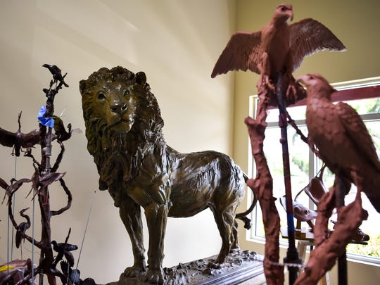 "Sculptor Geoffrey Smith's ""The Protector,"" a finished bronze lion, sits on display amid other works in various stages July 27, 2017, at his studio and gallery at 4545 SE Dixie Highway in south Stuart."