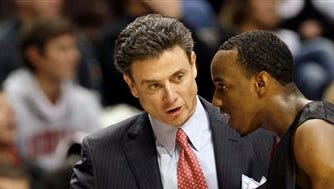 """FILE - In this Nov. 30, 2008, file photo, Louisville head coach Rick Pitino talks with guard Andre McGee, right, in the first half of an NCAA college basketball game against Western Kentucky in Nashville, Tenn. Escort Katina Powell says she has no proof that Louisville coach Rick Pitino knew that a former Cardinals staffer hired her and other dancers to strip and have sex with former recruits and players. But Powell said Tuesday, Oct. 20, 2015, on ABC's """"Good Morning America"""" that with """"a boatload"""" of recruits and dancers, """"loud music, alcohol, security, cameras"""" in a campus dormitory and others aware of the shows, """"how could he not know?""""  (AP Photo/Mark  Humphrey, File)"""