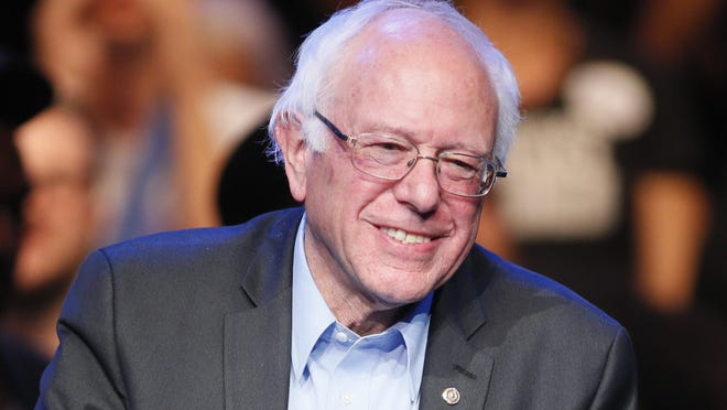 In this Wednesday, Oct. 14, 2015 file photo, Democratic presidential candidate Sen. Bernie Sanders, of Vermont, smiles while speaking during a fundraiser at the Avalon Hollywood, in Los Angeles.