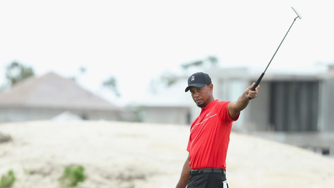 Tiger Woods reacts to a missed putt on the third hole during the final round of the Hero World Challenge at Albany, The Bahamas on Dec. 4 in Nassau, Bahamas.