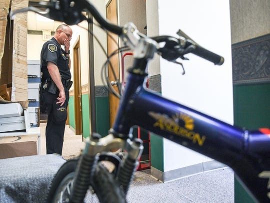 Capt. Doyle Carpenter stands near a city police bicycle