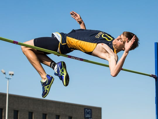 Delta's Kyle Wills competes in the high jump during