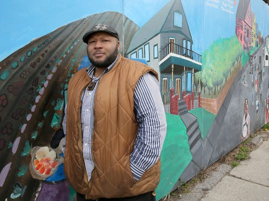 Terron Edwards, seen here in a 2015 photo, serves as coordinator of the Men's Wellness Project and is one of the Peace Project facilitators at Walnut Way Conservation Corp.