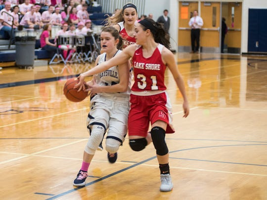 Marysville High School's Annah Fair (left) is blocked by Lake Shore's Kara Wolfbauer in the Pink Out basketball game at Marysville High School Jan. 25.