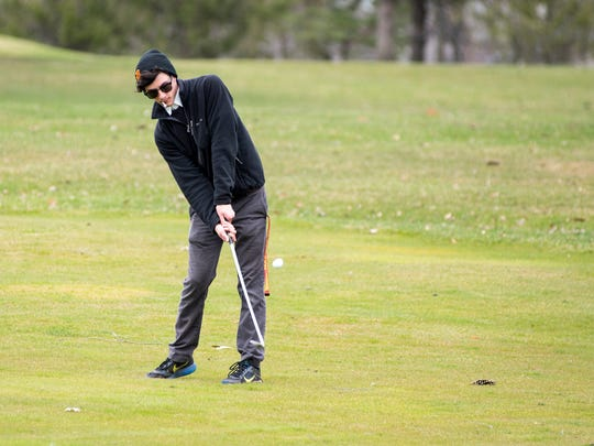Port Huron High School senior Nick Johnson tees off Tuesday, April 24 at the St. Clair Golf Club while competing against golfers from St. Clair High School.