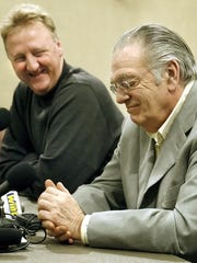 Larry Bird, left, considers Donnie Walsh a mentor.
