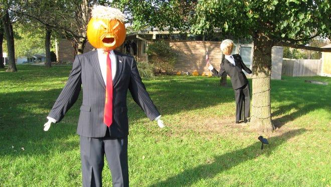 A Pencekin now accompanies a Trumpkin in a Carmel resident's front yard.