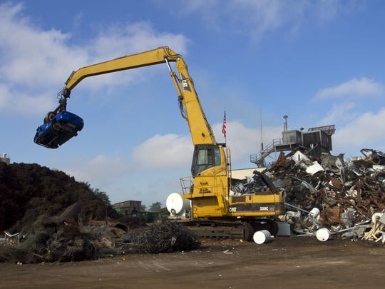 A car is lifted onto the automobile shredder at Garden Street Iron & Metal. The machine can shred a car in 16 seconds.