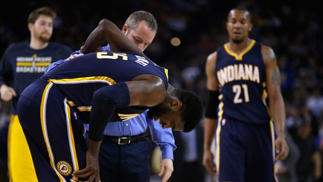 Roy Hibbert #55 of the Indiana Pacers is helped off the court after an injury during their game against the Golden State Warriors at ORACLE Arena on January 7, 2015 in Oakland, California.