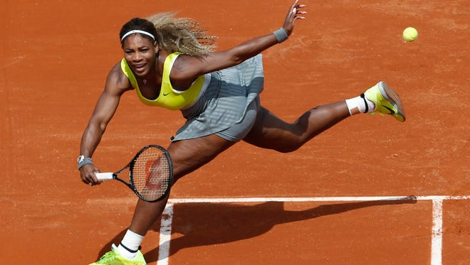In this May 25, 2014, file photo, Serena Williams makes a return against Alize Lim during a first round match at the French Open.