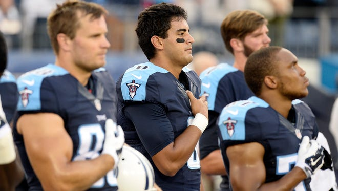 Tennessee Titans quarterback Marcus Mariota (8) stands for the national anthem before a preseason NFL football game against the St. Louis Rams Sunday, Aug. 23, 2015, in Nashville, Tenn.
