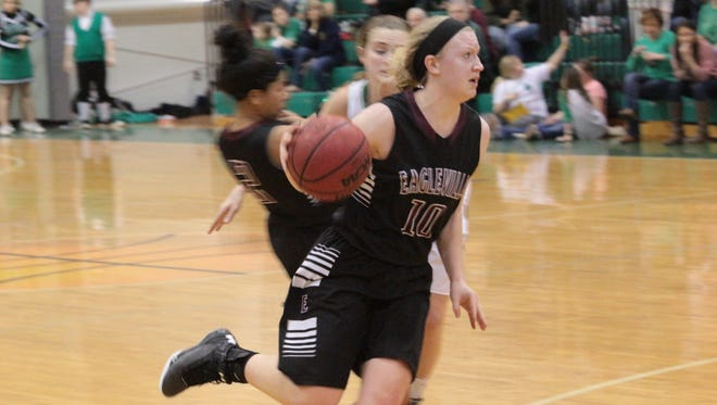 Eagleville's Kristin Barnes (10) drives past a Houston County defender during the second half of their Region 5-A tournament quarterfinal Friday in Erin.