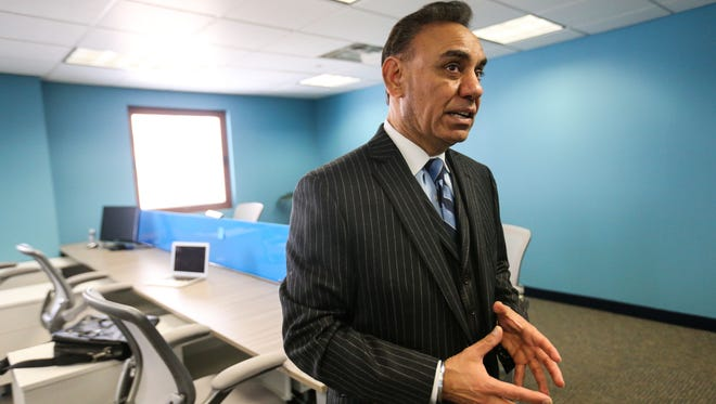 Alpha Technologies CEO Harry Virk is seen in the company's new global headquarters at the One Customs House in downtown Wilmington. Virk hopes the company will create more than 240 full-time jobs in Delaware by 2019.