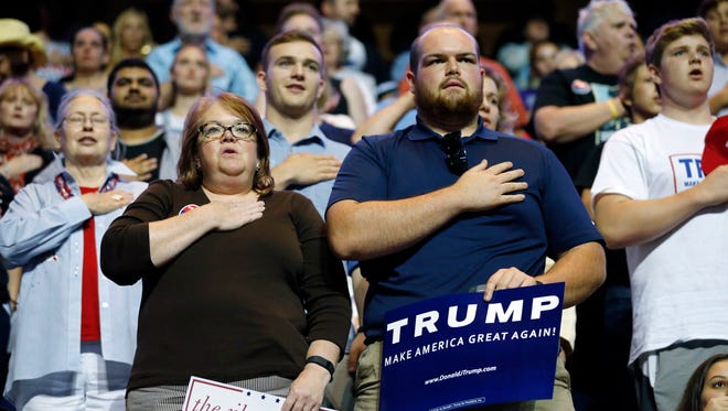 Supporters of Republican presidential candidate Donald Trump recite the Pledge of Allegiance during a rally for the candidate in Richmond, Va., on June 9, 2016.