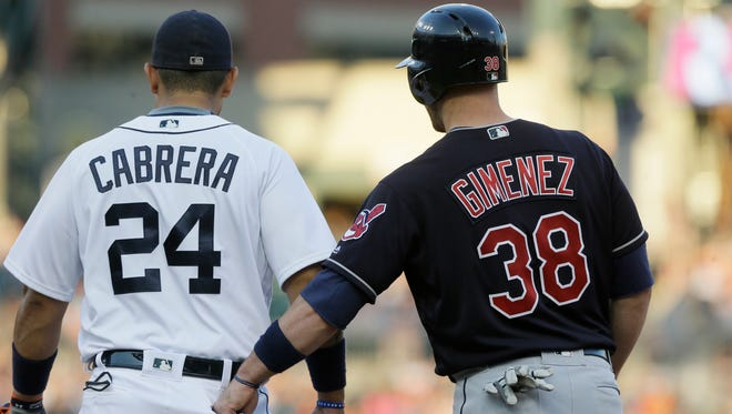 Cleveland's Chris Gimenez, right, reaches into Detroit's Miguel Cabrera's pocket for sunflower seeds during the fourth inning Friday in Detroit.