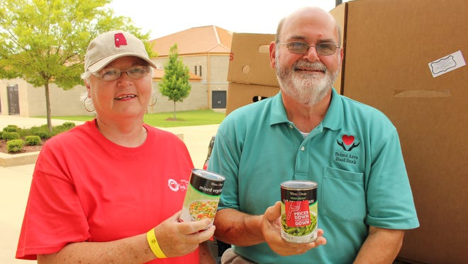 Jeff and Donna Harrison collected hundreds of food items for the Selma Area Food Bank to help the poor in Alabama's Black Belt.