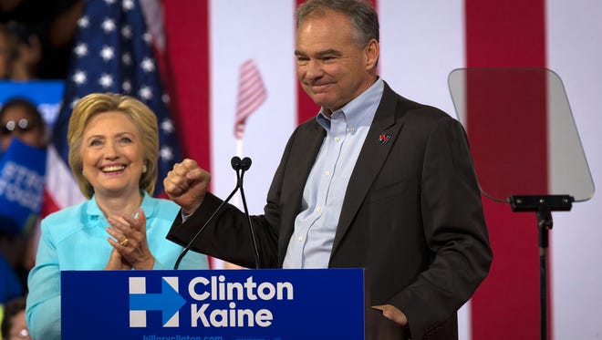 Sen. Tim Kaine, D-Va., speaks alongside Hillary Clinton at a campaign rally at Florida International University in Miami on Saturday, July, 23, 2016. The rally was Kaine's first public appearance after being named Clinton's vice presidential running mate.