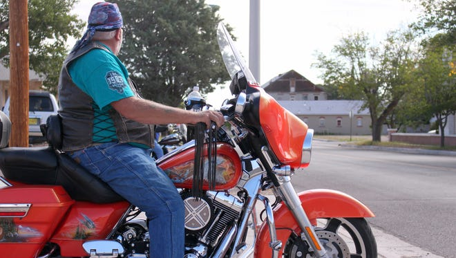 1. Jeremy Oliver of Muskogee, Oklahoma awaits a clearing in traffic during Saturday's Ride for Vets Fall Rally at American Legion post #4. Oliver traveled in support for a veteran friend to participate in the charity ride.