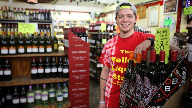 """Brandon Ware, 24, won $500,000 from a scratch-off lottery ticket purchased at Bartlett Wine & Spirits, where he's employed. """"I still don't believe I have the money,"""" he said."""