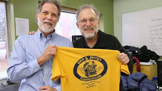 Journal Sentinel reporter Bruce Vielmetti shows Ben & Jerry's co-founder Jerry Greenfield the T-shirt he won for being a finalist in an ice-cream-eating contest held by the fledgling company nearly 40 years ago, on Jan. 20, 2017.